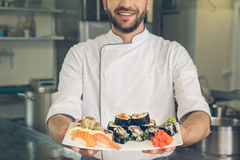 Man japanese restaurant chef cooking in the kitchen Royalty Free Stock Photography