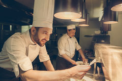 Man japanese restaurant chef cooking in the kitchen Royalty Free Stock Images