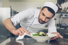 Man japanese restaurant chef cooking in the kitchen Stock Photos