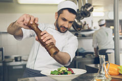 Man japanese restaurant chef cooking in the kitchen Stock Images