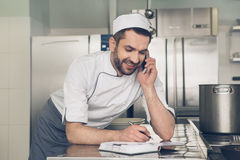 Man japanese restaurant chef working in the kitchen Royalty Free Stock Image