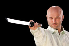 Man with a Japanese sword Royalty Free Stock Photo