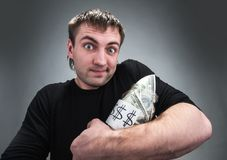 Man with jar of dollars Stock Photo