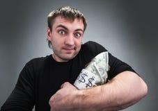 Man with jar of dollars Stock Photo