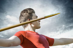 Man javelin throw. Attractive young man concentrates to throw his metallic  javelin Stock Photo