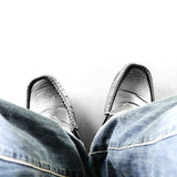 Man with jean sitting. Top view man with jean sitting Royalty Free Stock Photo