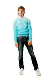 Man in jeans. A happy young man in jeans and a shirt on a white background Royalty Free Stock Images