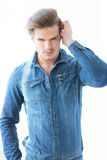 Man in jeans clothes arranging his hair Royalty Free Stock Photo