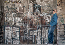 Man in jeans on graffiti background Royalty Free Stock Photography