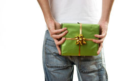 Man in Jeans holding gift Stock Photo