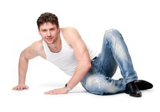 Man in jeans  is on an isolated background Royalty Free Stock Photo