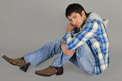 Man in jeans and a plaid shirt Stock Images