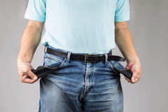 Man in jeans pulling out his empty pockets Stock Photography