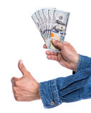 Man in jeans shirt holding dollar bills Stock Photography