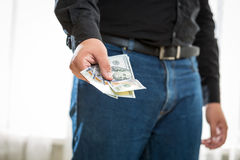 Man in jeans and shirt holding hundred dollar banknotes Stock Photos