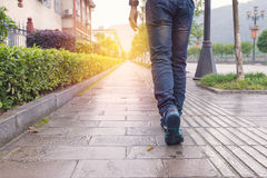 Man jeans and sneaker shoes walking on footpath Royalty Free Stock Photography