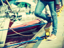 Man in jeans standing near harbor Royalty Free Stock Photo