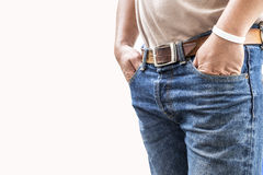 Man in jeans trousers on white background. Close up of a man in blue jeans stock images