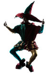 Man in jester costume silhouette jumping Royalty Free Stock Photos