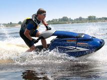 Man on jet ski. Rides very close Stock Photography