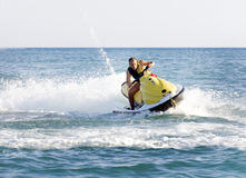 Man on a jet ski. A man on a jet ski Stock Images