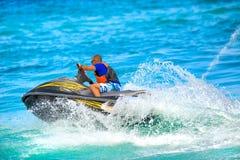 Man on jet ski. Riding royalty free stock photos