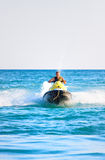 Man on a jet ski. Over a blue sea Royalty Free Stock Photography