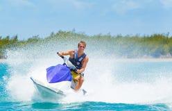 Man on Jet Ski. Having fun in Ocean Stock Photography
