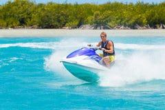 Man on Jet Ski. Having fun in Ocean Stock Images