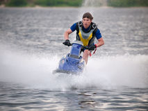 Man on jet ski rides fast Stock Photography