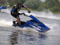 Man on jet ski in the river. Skim along very fast Stock Photography