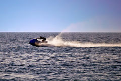 Man on jet ski silhouette. Sea at late afternoon Stock Image