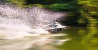Man on jet ski. Splashes on the river Stock Photos