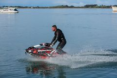 A man on a jet ski traveling at high speed royalty free stock photos