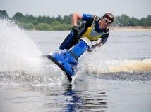 Man on jet ski very close. Man on jet ski in the river skims along camera very close Stock Photos