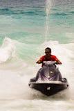 Man on Jetski. A man riding on a jetski in the sea Stock Photos