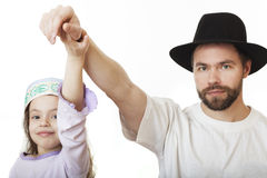 Man in Jewish hat and girl in skullcap. Man in Jewish hat and girl in skullcap (family Stock Images