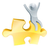 Man on jigsaw piece concept. Of a happy mascot man with arms raised seated on a jigsaw piece Stock Image