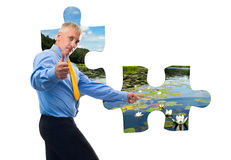 Man with jigsaw puzzle Stock Image
