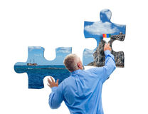 Man with jigsaw puzzle Royalty Free Stock Photos