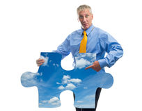 Man with jigsaw puzzle Stock Photography