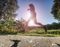 Man jogger run in park sunny day. Man is training stock images