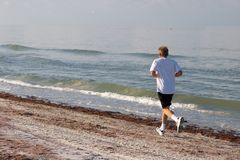 Man Jogging. On the Beach Royalty Free Stock Images