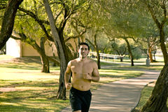 Man jogging. Fit man jogging in the park Stock Photos
