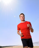Man jogging at a beach Stock Image