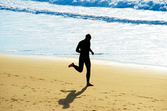 Man jogging on a beach Royalty Free Stock Image