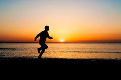 Man jogging  on beach Stock Image
