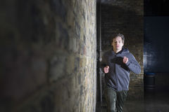 Man Jogging Besides Brick Wall Royalty Free Stock Photos