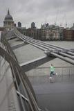 Man Jogging On Bridge Stock Photo