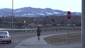 Man Jogging On Dust Car Drive stock video